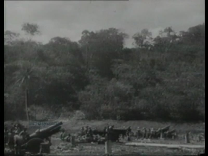 US troops set up camp and defense positions. US artillery brings down Japanese bombers. Guadalcanal, 1942