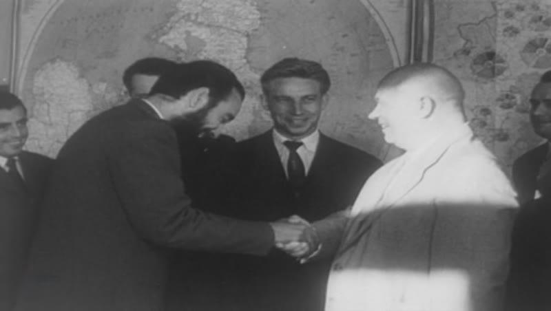 Antonio Núñez Jiménez, the Rebel Army Captain, greets Nikita Khrushchev, CU of Castro during speech. C.1960