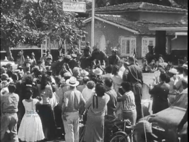 Fidel Castro enters Havana riding on hood of jeep - Cuban Revolution 1959