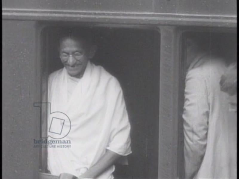 Various shots of Gandhi after long prison hunger strike, India, 1930s