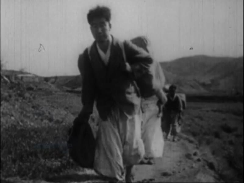 Korean refugees crossing the North-South border, refugee camp with adults and children sleeping and eating. 1950