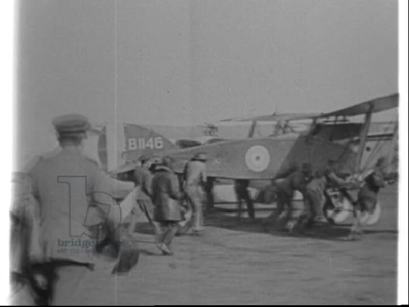General Birdwood leaves on plane, AFC pilots load Martinsyde plane with Hale bombs in preparation for mission in Palestine, WWI 1918