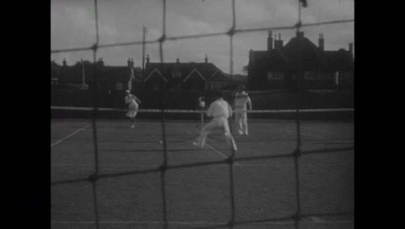 Playing tennis and walking the dog, 1930s