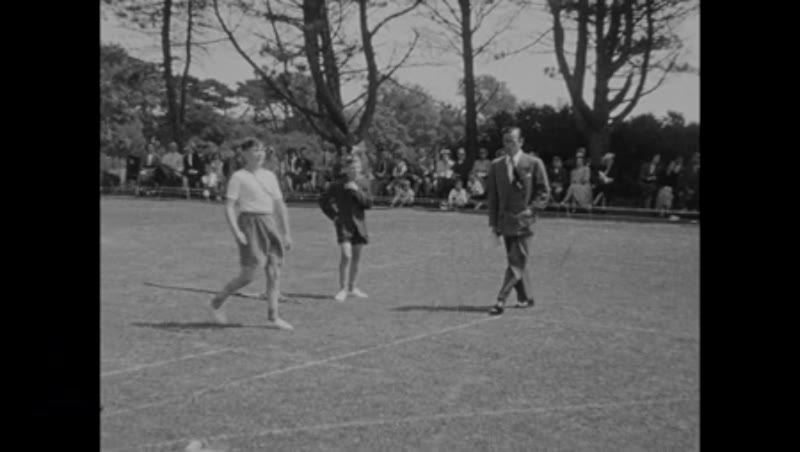 Toddler and puppy, sports day at Falconbury School, England, c.1952