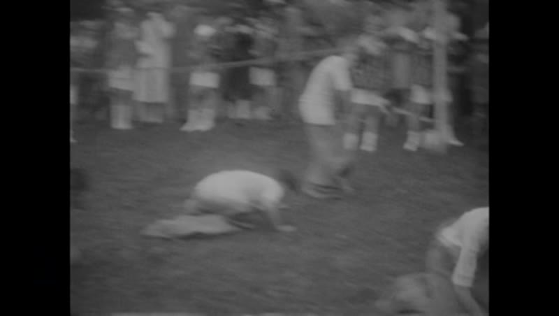 Sports day, England c.1930 - high jump, running, fathers' race, sack race, three-legged race, etc.
