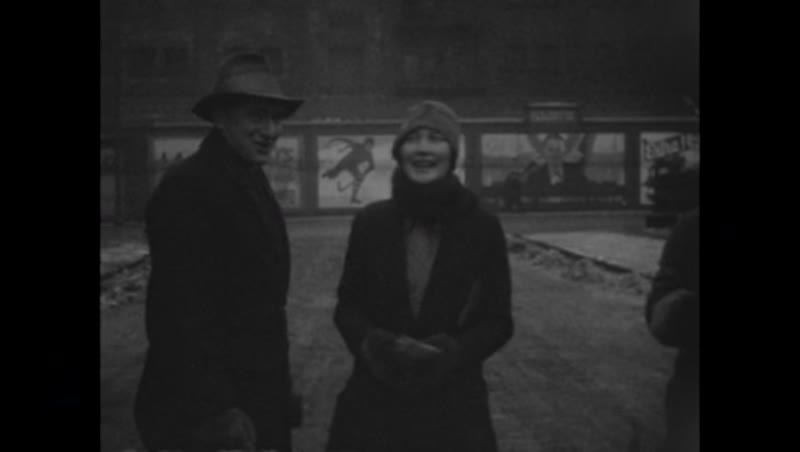 Friends in front of camera in winter clothes c.1930