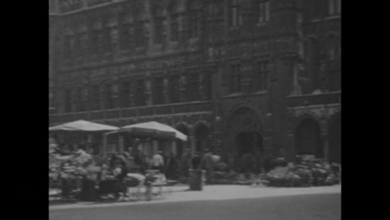 General views and street scenes in Brussels, 1934 - two men at a cafe, traffic, Bourse building, Royal Palace