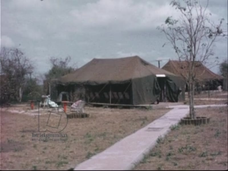 Shots of the entrance to the 101 Field Battery of the Royal Australian Artillery. Views of empty sergeants' club. Vietnam 1966-7