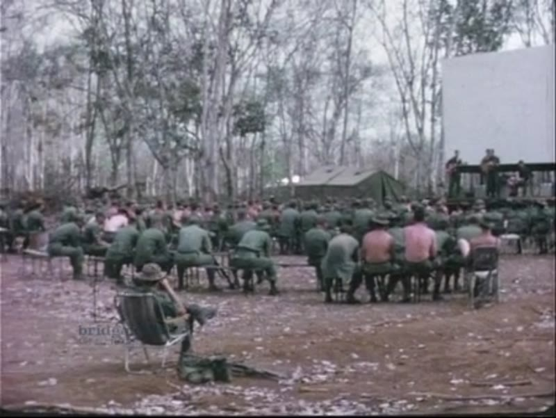 Australian army watching an American band in Vietnam, 1966-7