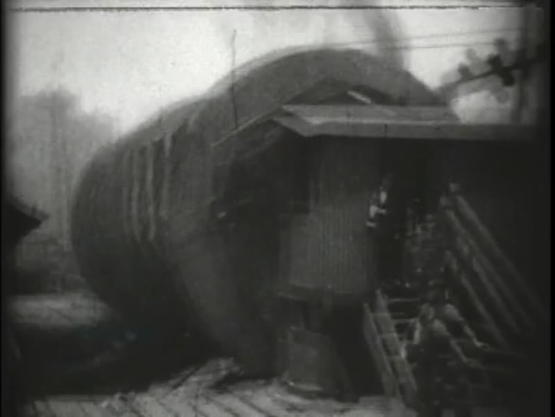 Rolling mechanism on building site. Early Edison film, 1902
