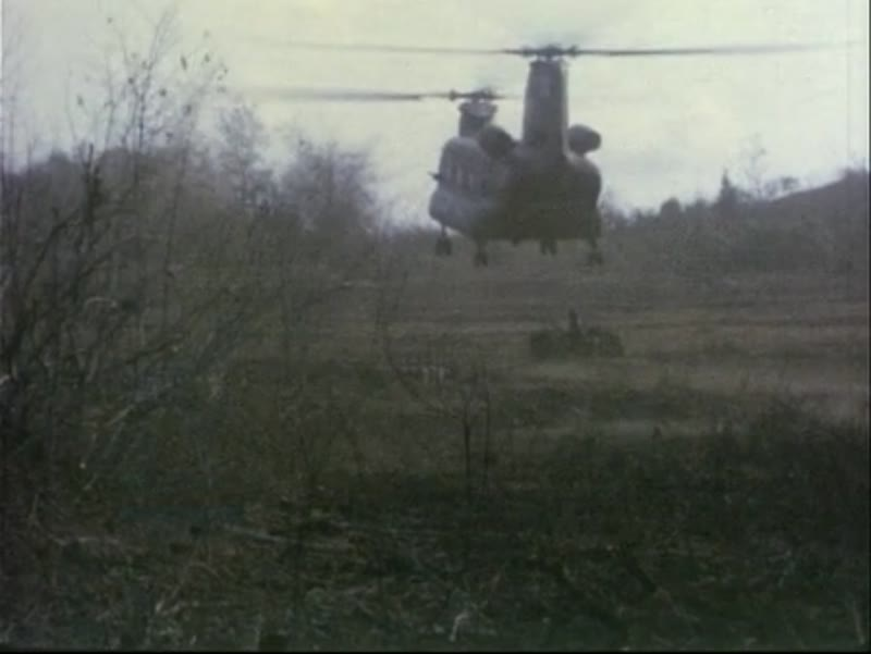 Operation Portsea, Vietnam, 1967 - Australian and US troops. Chinook takes off. Aerial view of camp.