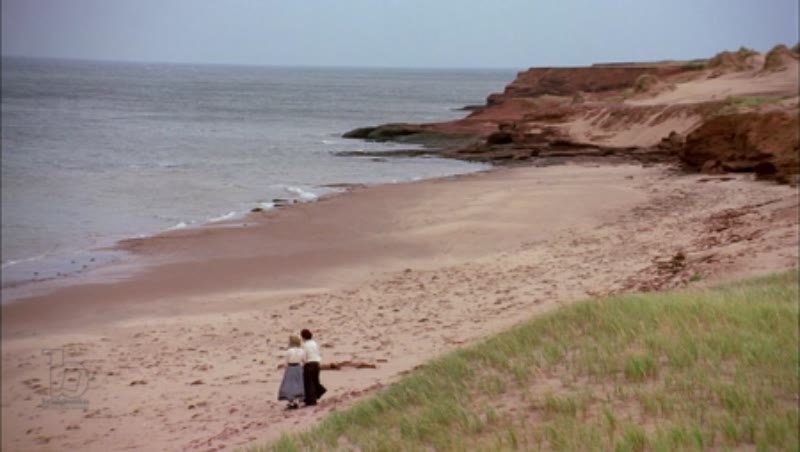 Long shot of beach with two women on sand, horizon in background, 1908 - reenactment