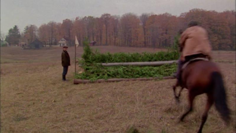 Man on horseback riding through the countryside, 1908 - reenactment. Clip 6