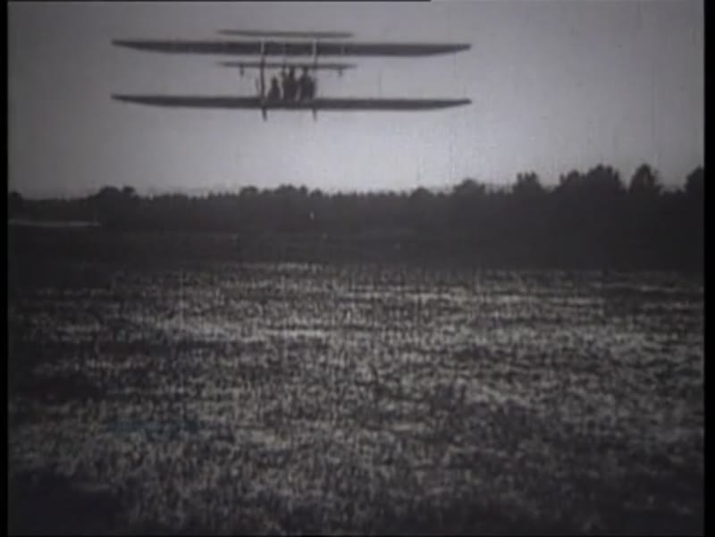 Franz Reichelt's fatal jump from the Eiffel Tower, and Wright Brothers test their biplane at Kitty Hawk. 1903