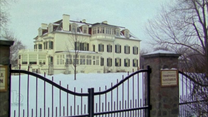 Static shot of a sanitorium in the snow, clip 2