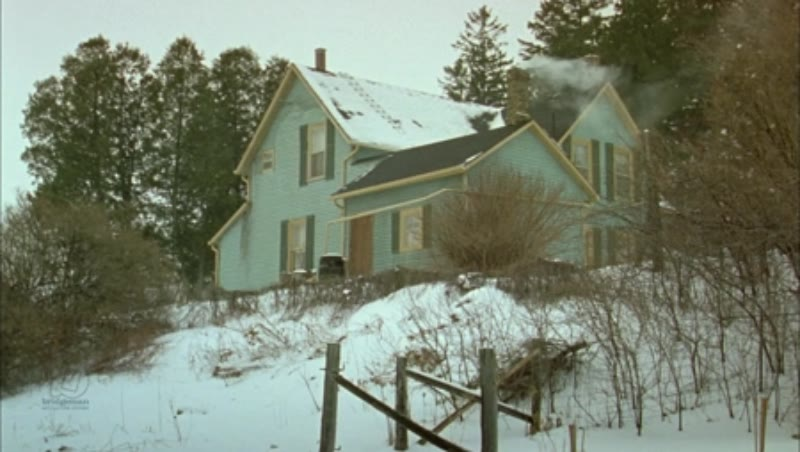 Static shot of a country home in the countryside by day in the snow, clip 10