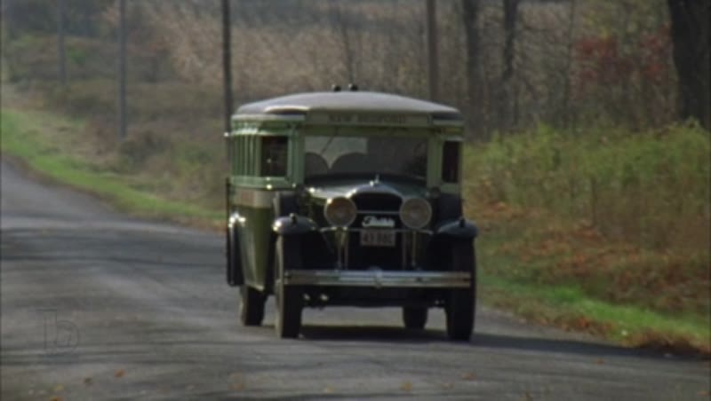 Bus driving through the countryside, 1930s - reenactment