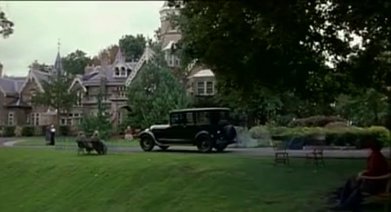 Car driving through a town, 1908 - reenactment