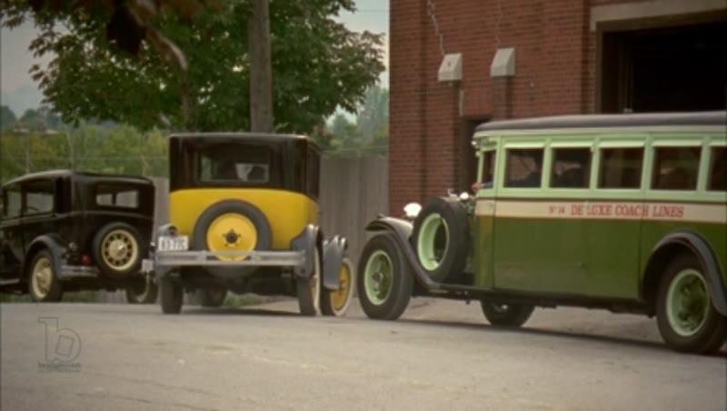 Car driving through town, 1930s - reenactment, clip 2