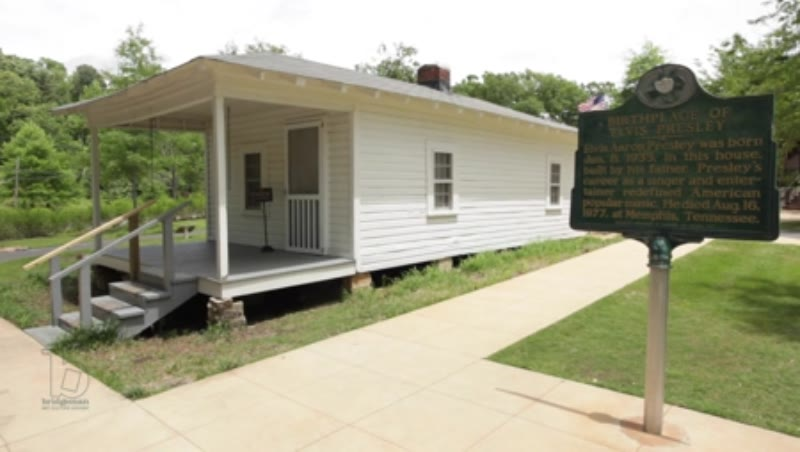 Birthplace of Elvis Presley, shot of house with sign in foreground, Tupelo, Mississippi