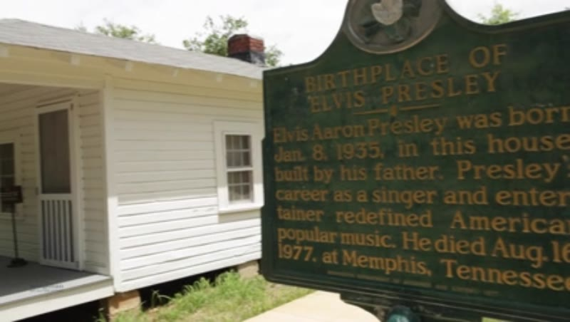 Birthplace of Elvis Presley. CU of sign and shot of house. Tupelo, Mississippi, USA.