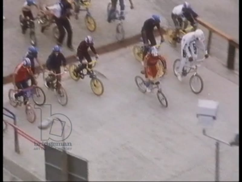 Cycling for London, 1983, part 7 - montage of cyclists, kids riding BMX bikes around a track, interview with member of GLC.