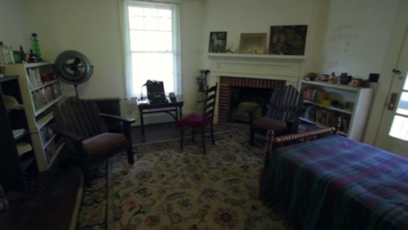 Rotating interior shot of a bedroom inside Rowan Oak, the home of William Faulkner in Oxford, Mississippi, clip 2