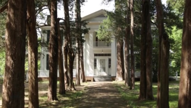 Tilt shot of the exterior of Rowan Oak, the home of William Faulkner in Oxford, Mississippi, clip 2