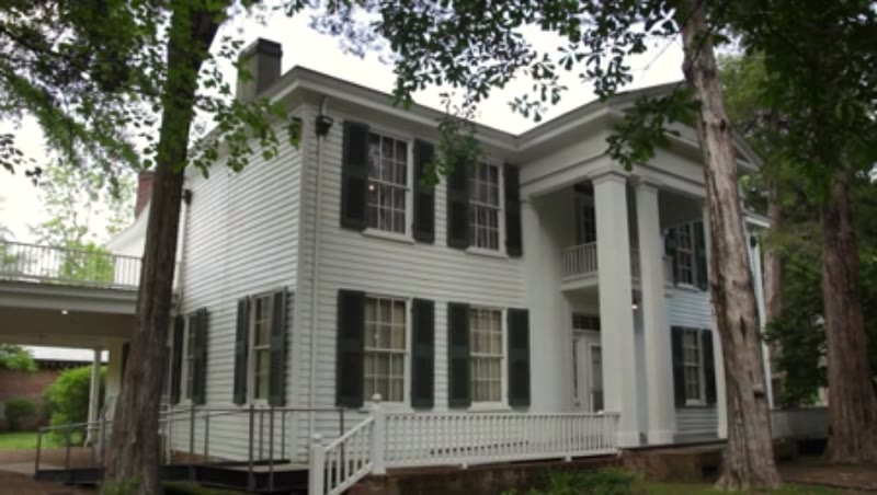 Tilt shot of the exterior of Rowan Oak, the home of William Faulkner in Oxford, Mississippi