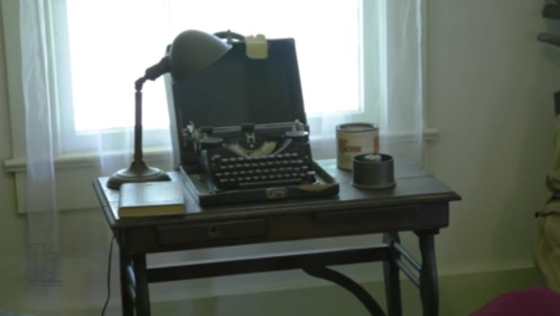 Static interior shot showing a typewriter on a desk inside Rowan Oak, the home of William Faulkner in Oxford, Mississippi