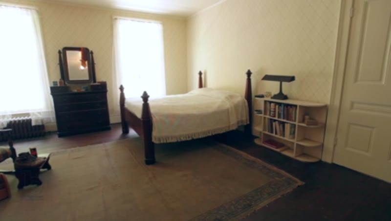 Rotating interior shot of a bedroom inside Rowan Oak, the home of William Faulkner in Oxford, Mississippi, clip 3