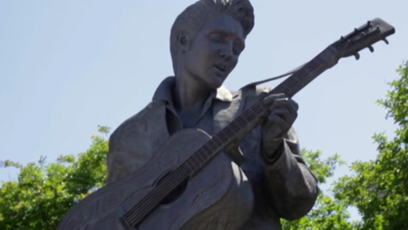 Tilt shot of a statue of Elvis Presley in Memphis, Tennessee, clip 2