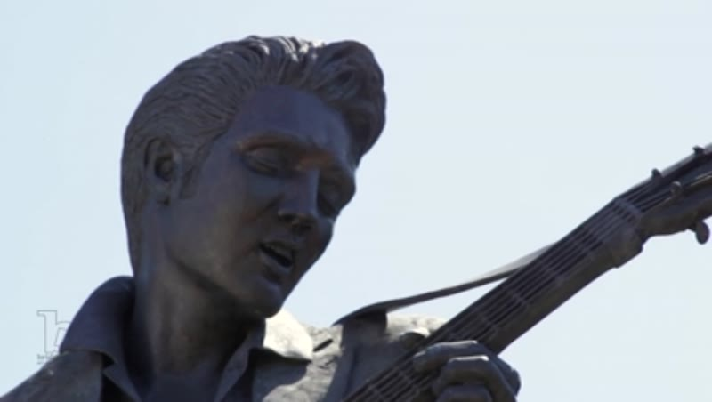 Tilt shot of a statue of Elvis Presley in Memphis, Tennessee