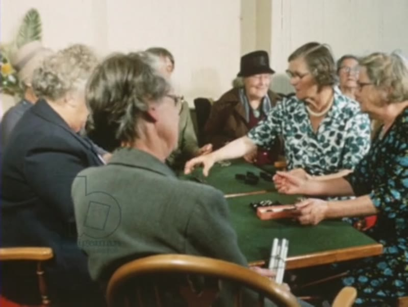 Somewhere Decent to Live 1967 part 13 - POV from car down Holloway Road, elderly friends playing dominoes