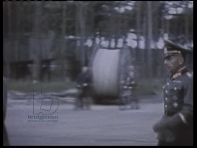 Himmler walking with SS oficers in German town, 1938, and at V-2 rocket testing in 1943