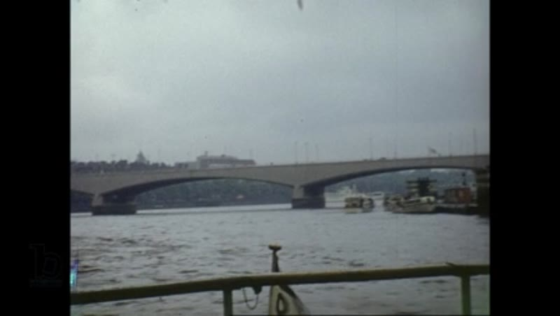 Views of Palace of Westminster, Waterloo Bridge and the Savoy Hotel - POV shot from boat on River Thames, London 1950s