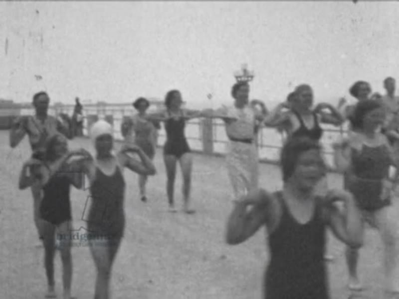 Outdoor exercise class and swimming in pool on Hastings seafront, England c.1937