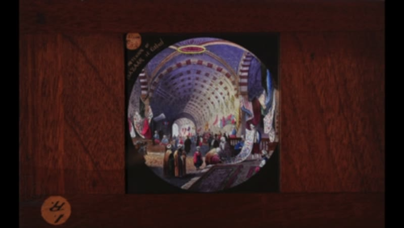 Animated 19th century magic lantern slide with a bazaar at day and night