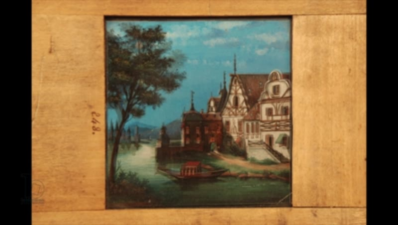 Animated 19th century magic lantern slide with dissolve from day to night