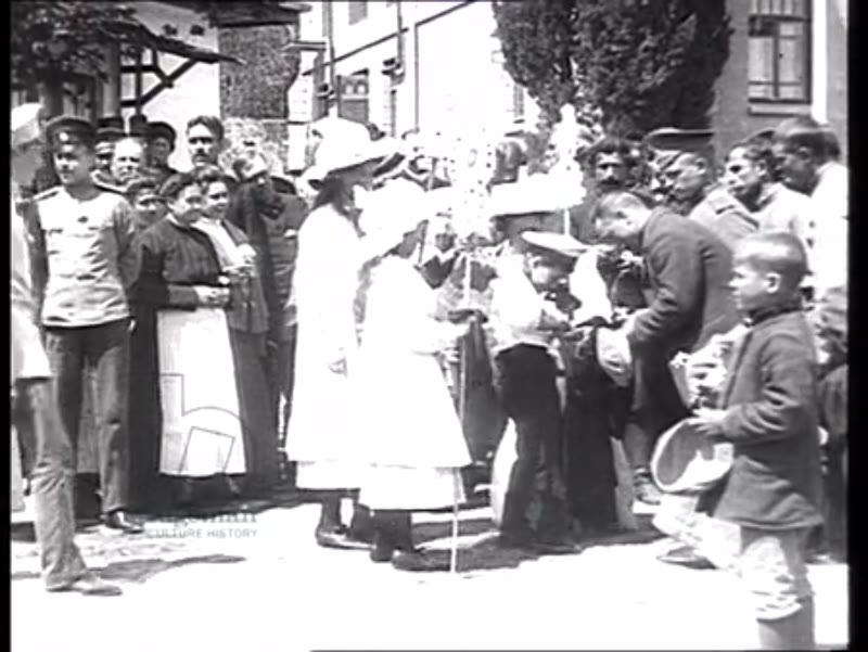 Tsar Nicholas II and his children collect charitable donations among peasant children, summer 1912 or 1914