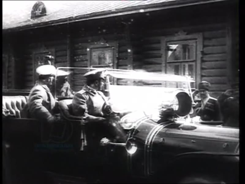 Tsar Nicholas II departs army headquarters by car, accompanied by Commander-in-Chief Grand Duke Nicholas Nicholaevich, Baranovichi, 1914-15