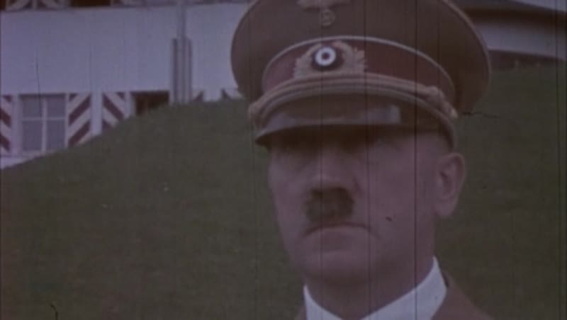 Close up of Adolf Hitler in colour. Looking ahead. Not talking.