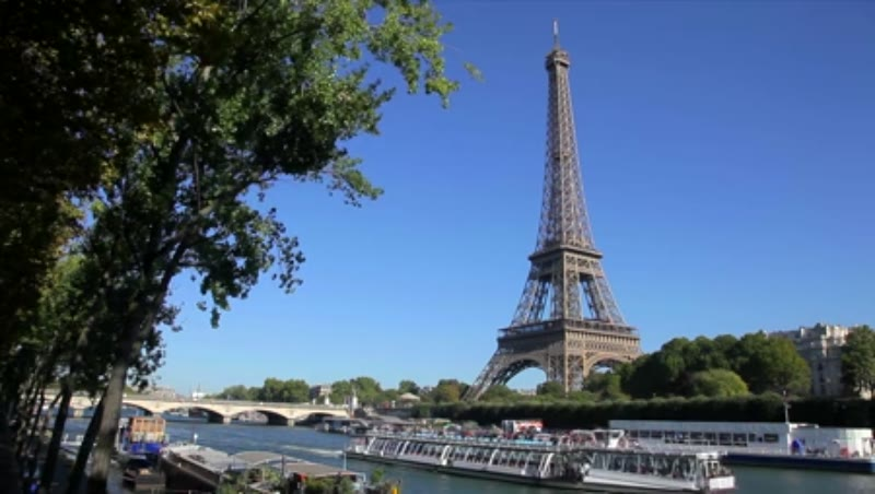 Static shot of Eiffel Tower behind the River Seine, Paris, France 2014