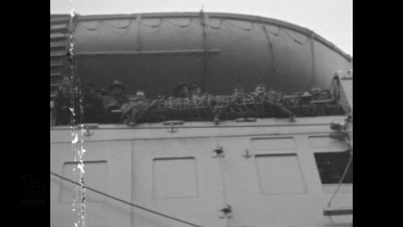 World War II: Queen Elizabeth Troop Carrier arriving into Wellington Harbour, New Zealand