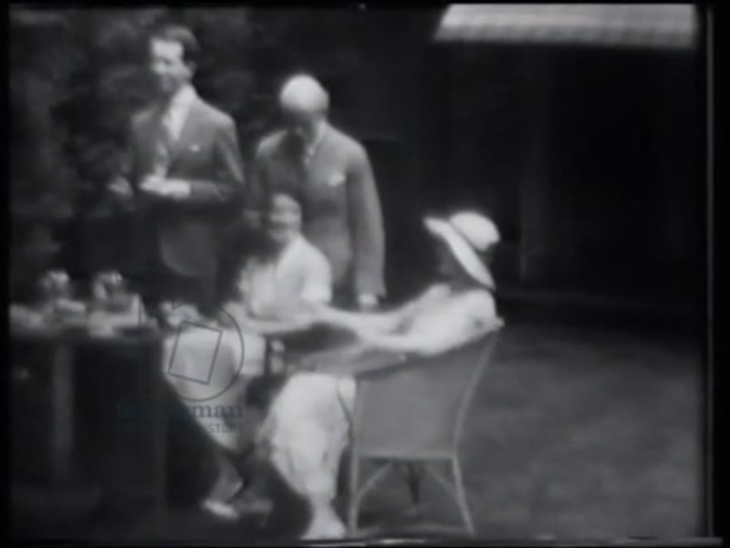 Miss Irene Hirst, Armand, 12th duc de Gramont and Irwin Boyle Laughlin having tea at 3 Fitzjohn's Avenue