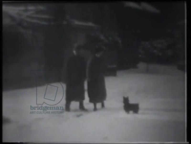 Philip and Lucy de László in garden after snowfall