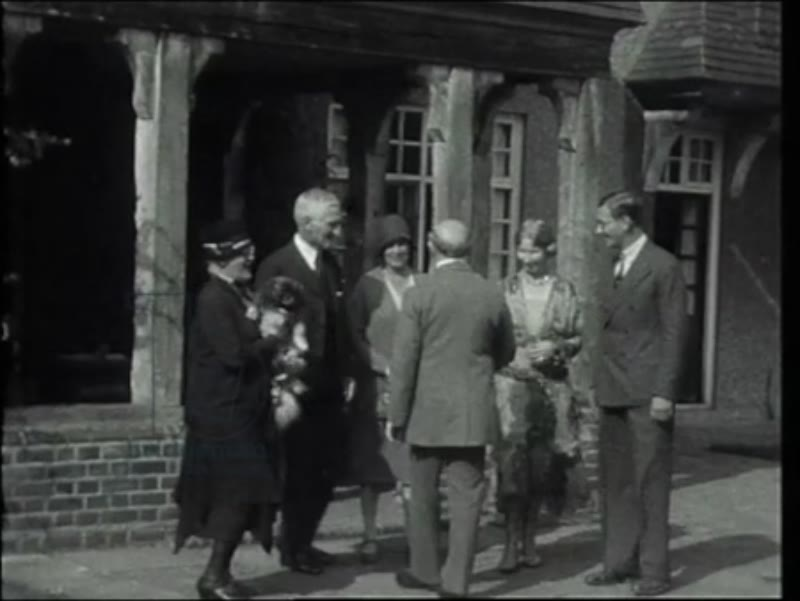Philip and Lucy de László, their son Henry and their Pekingese dog, Yang at Littleworth Corner