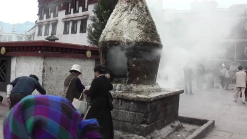 People feeding the Kora fire, Jokhang Temple, Lhasa, Tibet 2