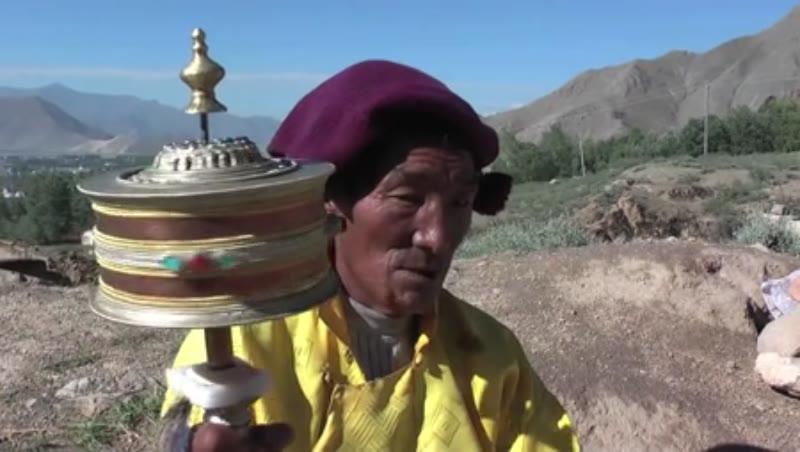 Old man with prayer wheel, Tibet