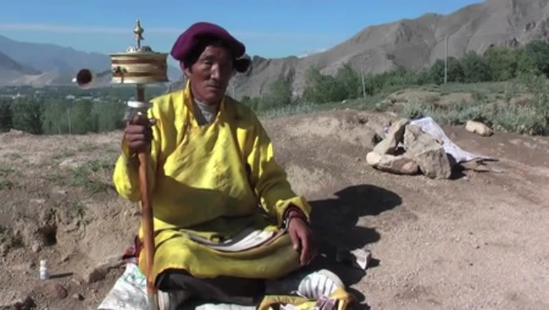 Old man with prayer wheel, Tibet 2